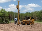 The Model 40 driving extra long steel pipe in the ground for high deer fence.