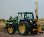 Black Cat Fence Post Driver - Model 40 on a John Deere tractor.